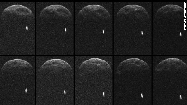 Large asteroid zipping past Earth, dragging its own moon along