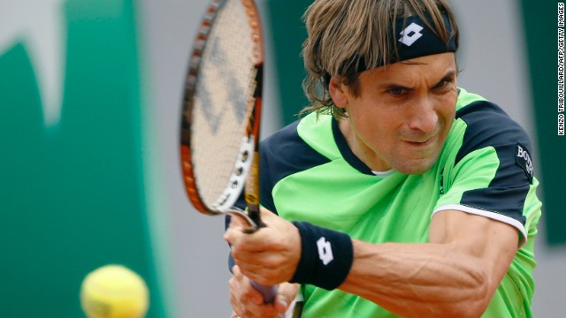 Spain's David Ferrer returns to his countryman Feliciano Lopez on May 31.