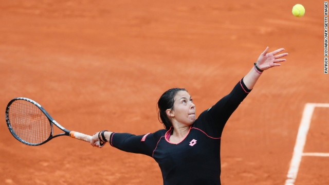 France's Marion Bartoli serves to Colombia's Mariana Duque-Marino on May 31. Bartoli won 7-6(5), 7-5.