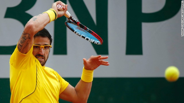 Serbia's Janko Tipsarevic hits a return to Spain's Fernando Verdasco on May 31.