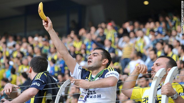 Racism has long been a stain on football but a resurgence of incidents in recent years has prompted soccer's authorities to launch a renewed bid to rid the game of discrimination for good. Here a Fenerbahce fan holds a banana towards Galatasaray's Ivory Coast striker Didier Drogba during a Turkish league match in May 2013.