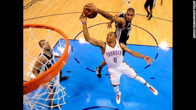 Duncan blocks a shot by the Oklahoma City Thunder's Russell Westbrook during last year's playoffs. Averaging more than two blocks a game throughout his entire career, Duncan has been named to the NBA's All-Defensive first or second teams in 14 of his 16 seasons.
