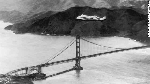 The Lockheed Electra 'Flying Laboratory' piloted by Earhart and Fred Noonan flies over the Golden Gate bridge in Oakland, California, at the start of a planned around-the-world flight on March 17, 1924. The trip had to be abandoned after the plane crashed on takeoff in Hawaii.