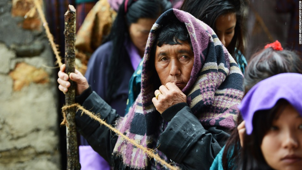MAY 31- PARO, BHUTAN: Bhutanese women stand in line outside a polling station on May 31, 2013. Bhutan begins its second ever parliamentary election on Friday, after polling officials trekked for up to seven days to reach voters in the most remote corners of the Himalayan kingdom.