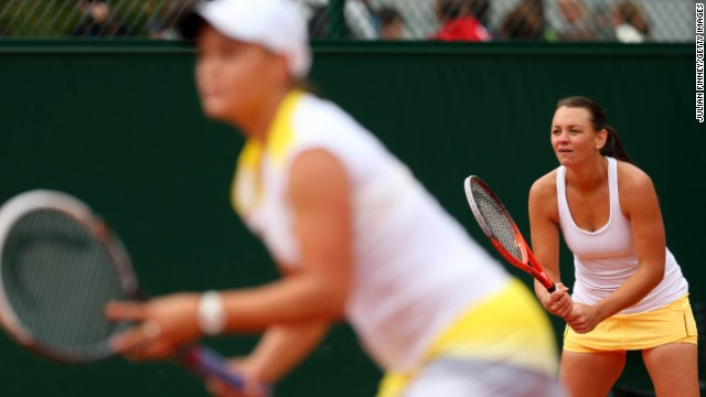 Casey Dellacqua, right, and Ashleigh Barty of Australia prepare to receive a serve on May 31. The pair lost to Mona Barthel of Germany and Liga Dermeijere of Latvia 3-6, 6-4, 6-3.