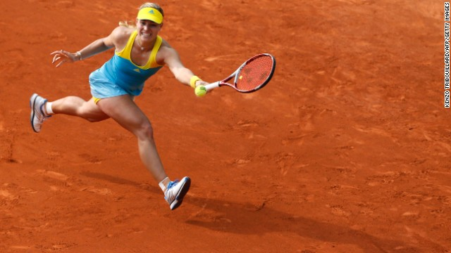 Angelique Kerber of Germany returns to Varvara Lepchenko of the United States on May 31. Kerber won 6-4, 6-7(3), 6-4.