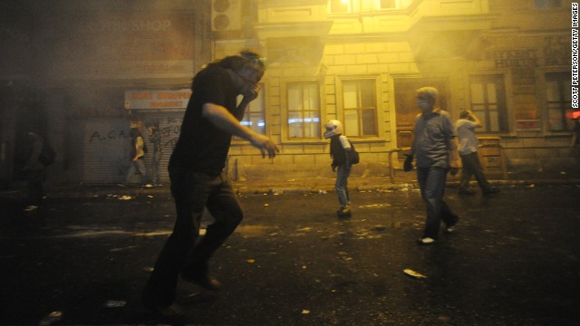Demonstrators set up barricades and build a fire as they clash with Turkish officers on May 31.