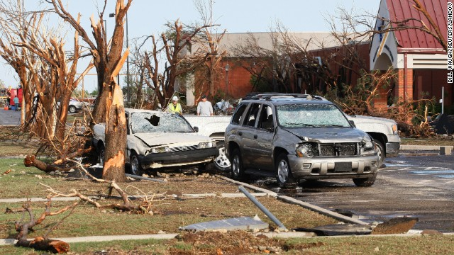 Destroyed trees and cars stand along a road at the Canadian Valley Technology Center in El Reno on June 1.