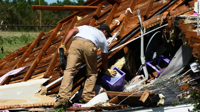 A man searches through the rubble of a home in El Reno on June 1. A large part of Moore, Oklahoma, was without power, as were parts of El Reno and Union City.