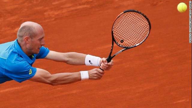 Russia's Nikolay Davydenko reaches to hit a return to France's Richard Gasquet on June 1. Gasquet won 6-4, 6-4, 6-3 .