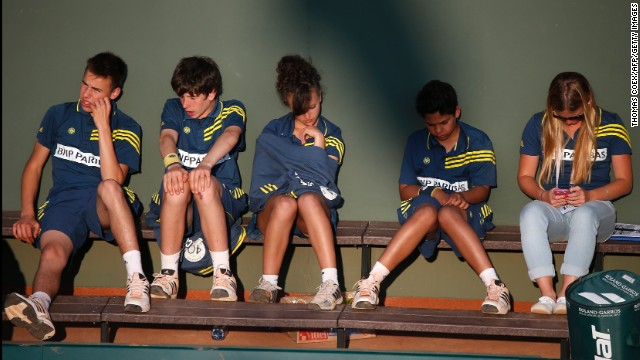 Ball boys and ball girls take a break during the tournament on June 1.