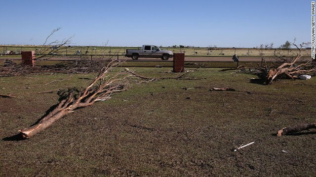 Downed trees sit in the parking lot of the Canadian Valley Technology Center in El Reno on June 1.