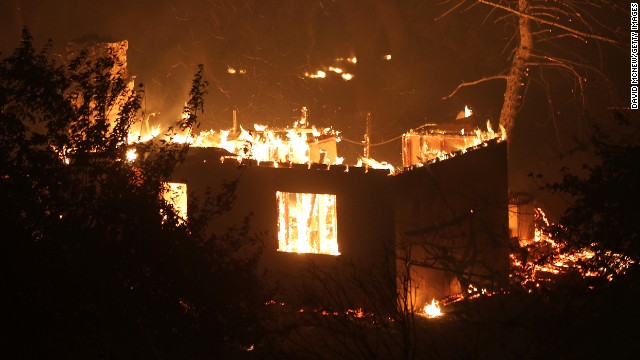 A house near Lake Hughes burns in the Powerhouse Fire on June 2.