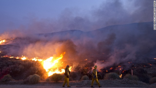 Firefighters battle the flames near Lake Hughes on June 2.