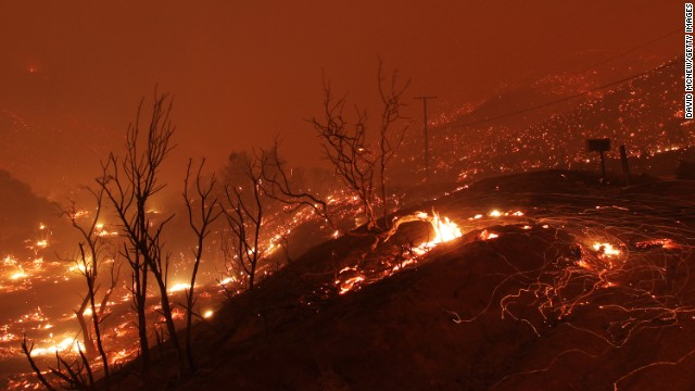 Hills glow with fire as the blaze sweeps through an area near Lake Hughes on June 1.