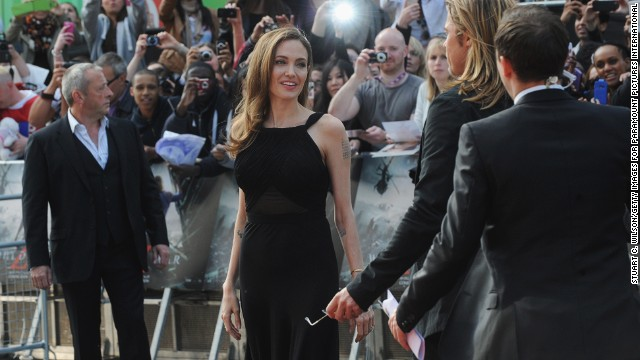 "In May 2013, Jolie announced in a New York Times op-ed that she underwent a preventive double mastectomy after learning that she carries a mutation of the BRCA1 gene, which sharply increases her risk of developing breast and ovarian cancer. Here, in June 2013, she makes her first red carpet appearance since the surgery, attending the London premiere of Pitt's movie ""World War Z."""