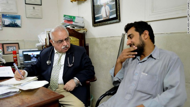 A psychiatrist talks to a patient in Peshawar, Pakistan. The country is also trying community-based approaches on mental health.