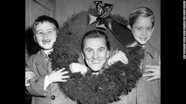 His father, actor Kirk Douglas, sits with his brother, Joel and Michael, at then-Idlewild Airport, in 1955. Michael is the eldest son.