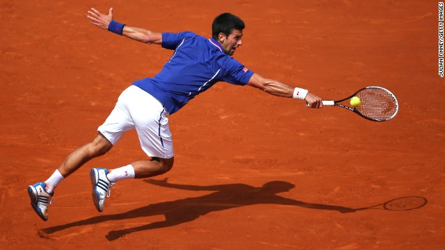 Serbia's Novak Djokovic dives for a backhand during his match against Germany's Philipp Kohlschreiber on June 3.