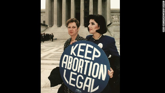 "Roe v. Wade (1973): Norma McCorvey, identified as ""Jane Roe,"" sued Dallas County District Attorney Henry Wade over a law that made it a felony to have an abortion unless the life of the mother was in danger. The court agreed with Roe and overruled any laws that made abortion illegal in the first trimester. Here, McCorvey, left, stands with her attorney Gloria Allred in 1989."