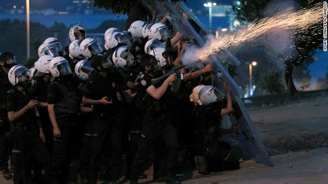 Turkish riot police fire tear gas canisters to disperse protesters near Taksim Square on June 3.