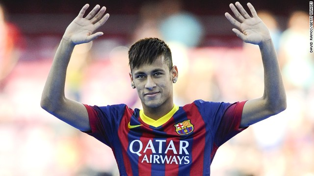 Neymar waves to a packed Nou Camp on the day he officially became a ...