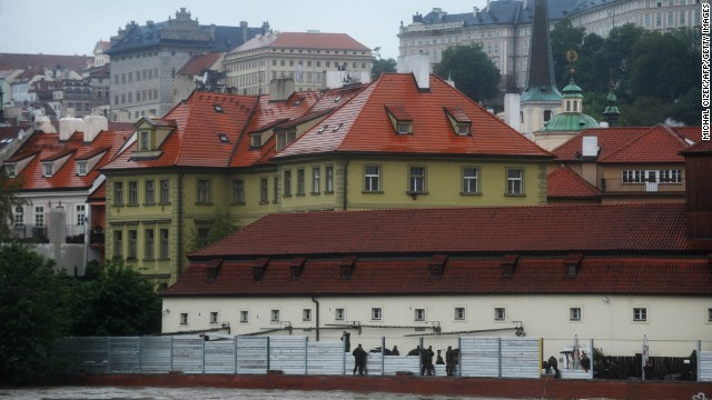Czech army personnel build flood barriers on the bank of the flooded Vltava River in Prague. Transportation was severely disrupted in Prague, as well as other parts of Bohemia, according to a spokeswoman for the Czech Fire Department.