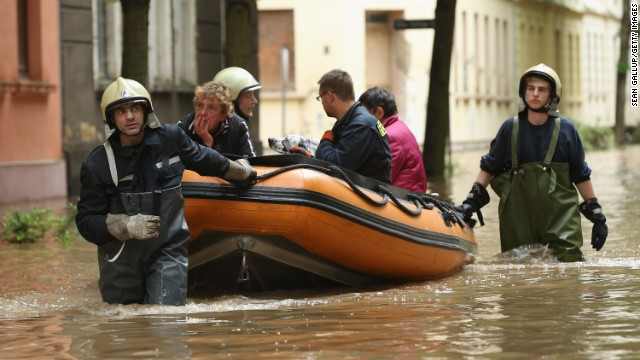 JUNE 4 - ZEITZ, GERMANY: Firefighters evacuate local residents from their flooded homes in Zeitz, Germany. Heavy rains are pounding southern and eastern Germany, Austria and western Czech Republic, causing heavy flooding. 11 people have died across the region so far, tens of thousands have been forced to leave their homes.