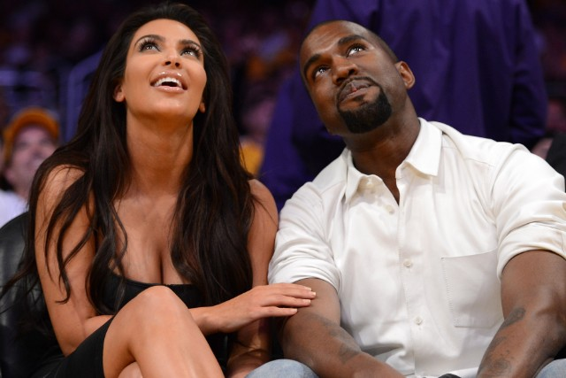 Kim Kardashian and Kanye West watch the Lakers play the Denver Nuggets.