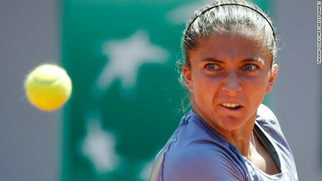 Sara Errani of Italy hits a return to Agnieszka Radwanska of Poland during a quarter final match on June 4. Errani defeated Agnieszka 6-4, 7-6 (6).