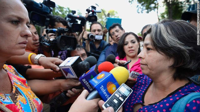 Relatives speak to media in front of the general attorney's office in Mexico City on May 31.