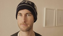 Sam Muirhead wearing his open-source woolly hat.