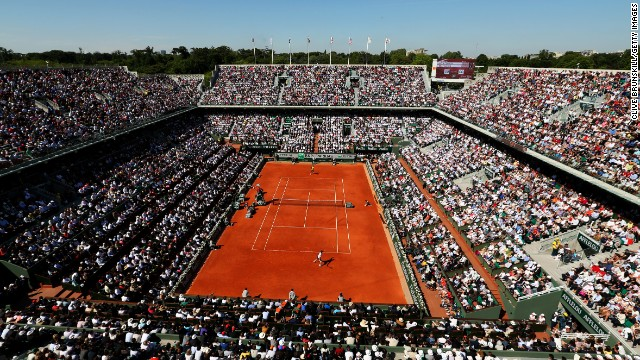 Jo-Wilfried Tsonga of France and Roger Federer of Switzerland face off at Philippe Chatrier court during their quarterfinal match on day 10 of the French Open on Tuesday, June 4, in Paris. Tsonga won 7-5, 6-3, 6-3.