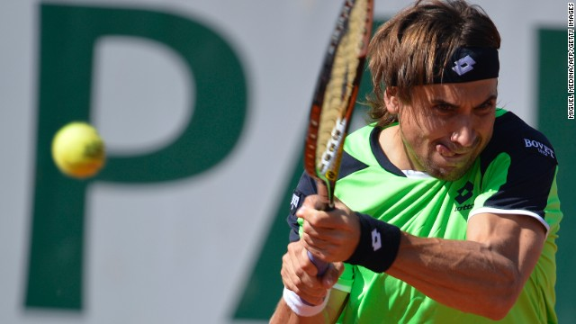 Ferrer plays a return to Robredo during the quarter final match.