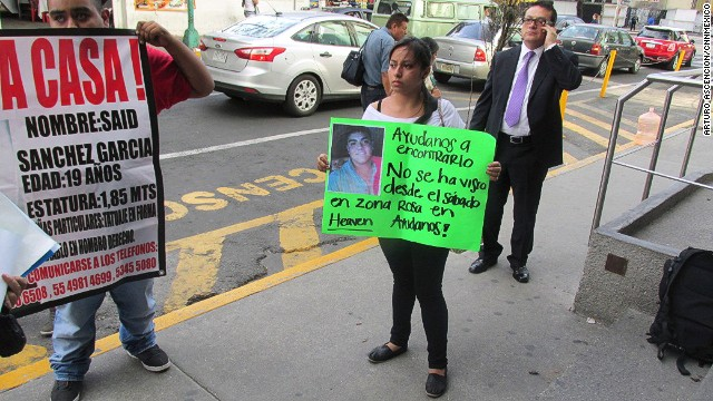 What happened to 12 young people who were forced at gunpoint into a van in Mexico City's popular Zona Rosa entertainment district on May 26? <a href='http://www.cnn.com/2013/06/04/world/americas/mexico-missing-mystery/index.html?iref=allsearch'>The mystery has gripped nation</a>. Penelope Ramirez is a cousin of Jerzy Ortiz Ponce, who is one of the 12 missing people. She holds a sign with his picture during a gathering of family members in the Tepito area of Mexico City on May 31.
