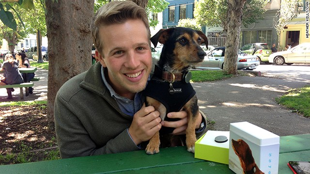 Whistle co-founder and CEO Ben Jacobs and beta tester Duke, who is displaying a company's new pet activity tracker.
