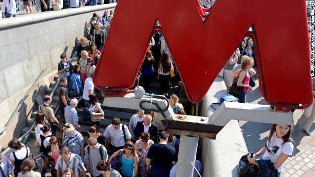 Commuters wait for the reopening of the Komsomolskaya metro station in Moscow. Thousands were evacuated after a fire.