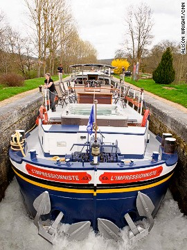 Going through the locks on the Burgundy Canal is an adventure in itself. Many have lock keepers -- beefy men who come running when barges pull up.