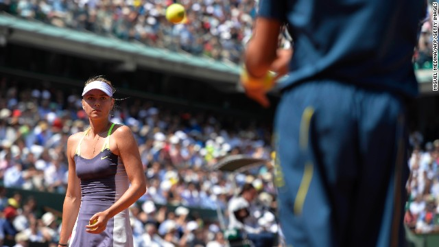 Russia's Maria Sharapova exchanges a ball before serving to Serbia's Jelena Jankovic on June 5. Sharapova won 0-6, 6-4, 6-3.