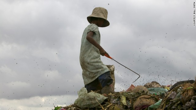 A girl searches for glass, plastic and metal at the landfill near Cambodia's capital. She and others have to combat flies, rats, snakes and the terrible stench.