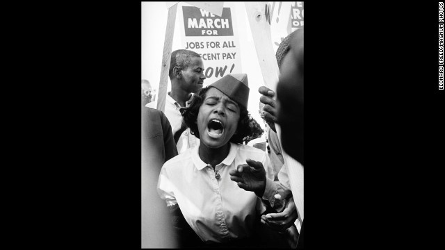 A woman sings during the March on Washington.