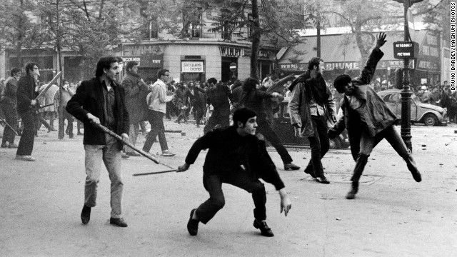 Students hurl projectiles at the police on Boulevard Saint Germain in Paris during the uprisings of May 6, 1968.