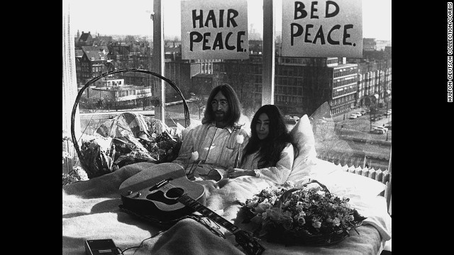 "John Lennon and Yoko Ono give a press conference during their ""bed-in"" for peace in an Amsterdam hotel in March 1969."