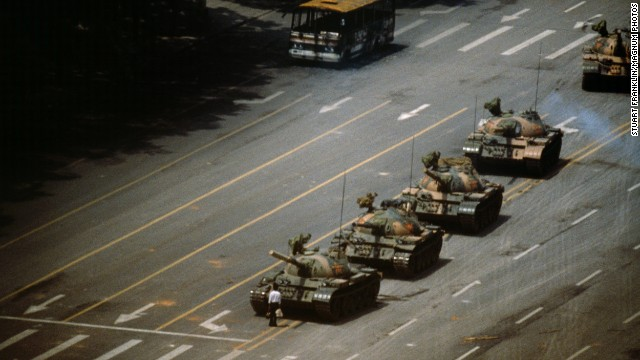 A man stands in front of a column of T-59 tanks on June 4, 1989, in Tiananmen Square in Beijing.