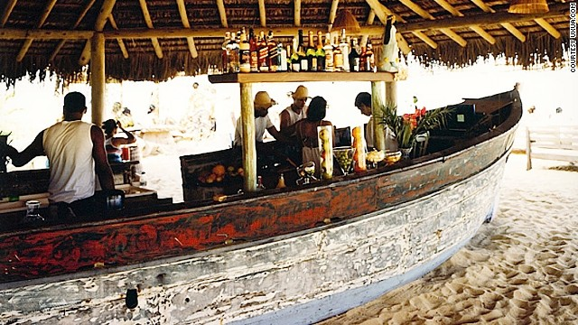 Featuring vast, cushioned sofas and flat-roofed pergolas, bar number 7 was built with reclaimed fishing boats that for years had languished on the site unused.
