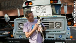 Bob Votruba, accompanied by his Boston terrier, Bogart, travels across the country to spread kindness.
