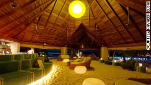 This Maldives bar is so chilled out they couldn\'t even be bothered putting down a floor.