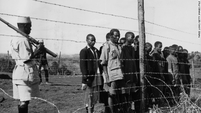 Men suspected of being members of the Mau Mau terrorist movement in a barbed wire compound in Kenya in 1955.