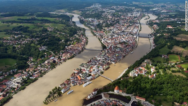 The Inn, left, and Danube rivers flood parts of the