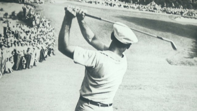 Ben Hogan plays his famous one-iron approach to the final green in the 1950 U.S. Open at Merion. It is acknowledged as one of the greatest shots in golfing history and he went on to win the tournament in a playoff.